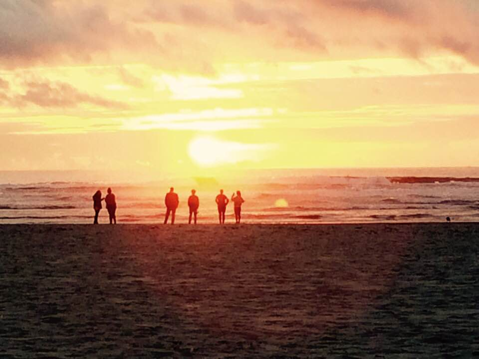 uLab members on beach with sunset